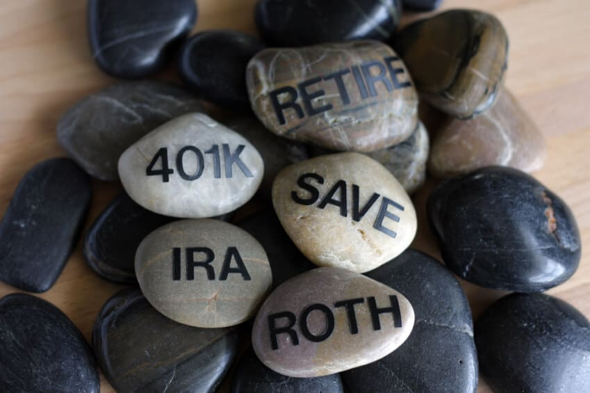 rocks stacked on top of each other with the words retire, 401k, save, IRA, and roth