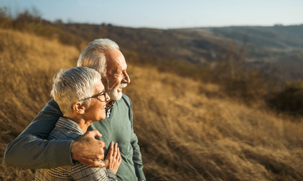 Older couple on hill looking at the horizon