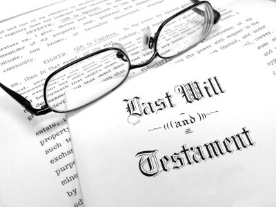 Last Will and Testament papers with glasses sitting on top