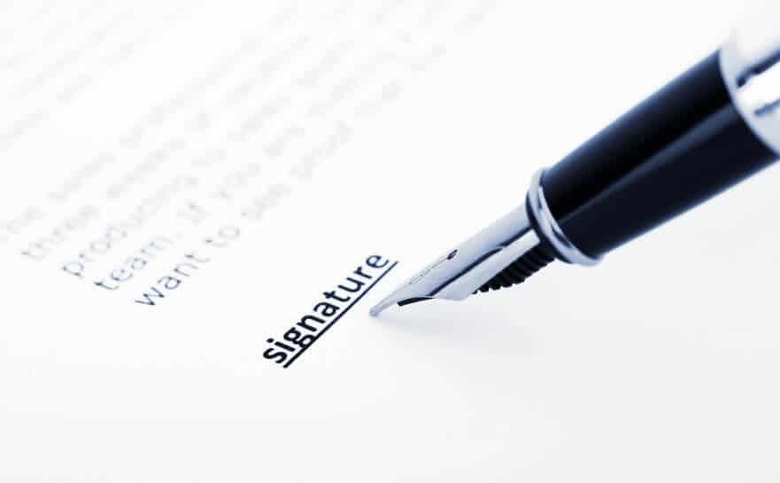 Image of pen signing name
