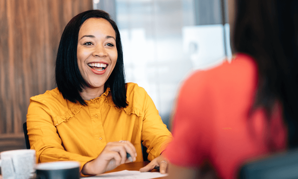 Business woman smiling while meeting with a client