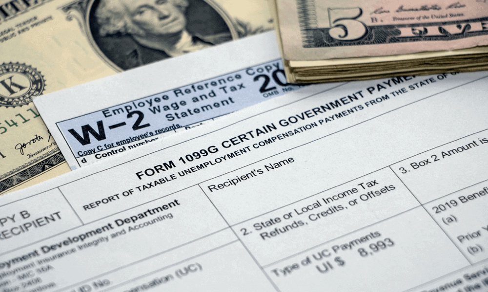 W-2 employee form on table with money around it