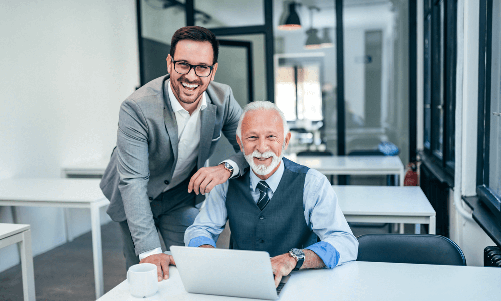 Father and son working together in a family office