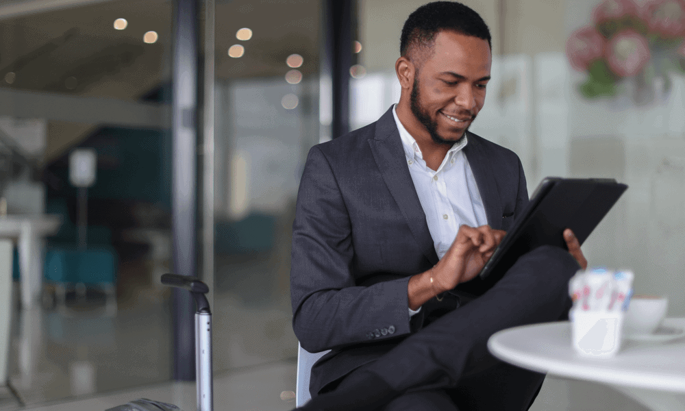 Business man in suit working on tablet while at a table